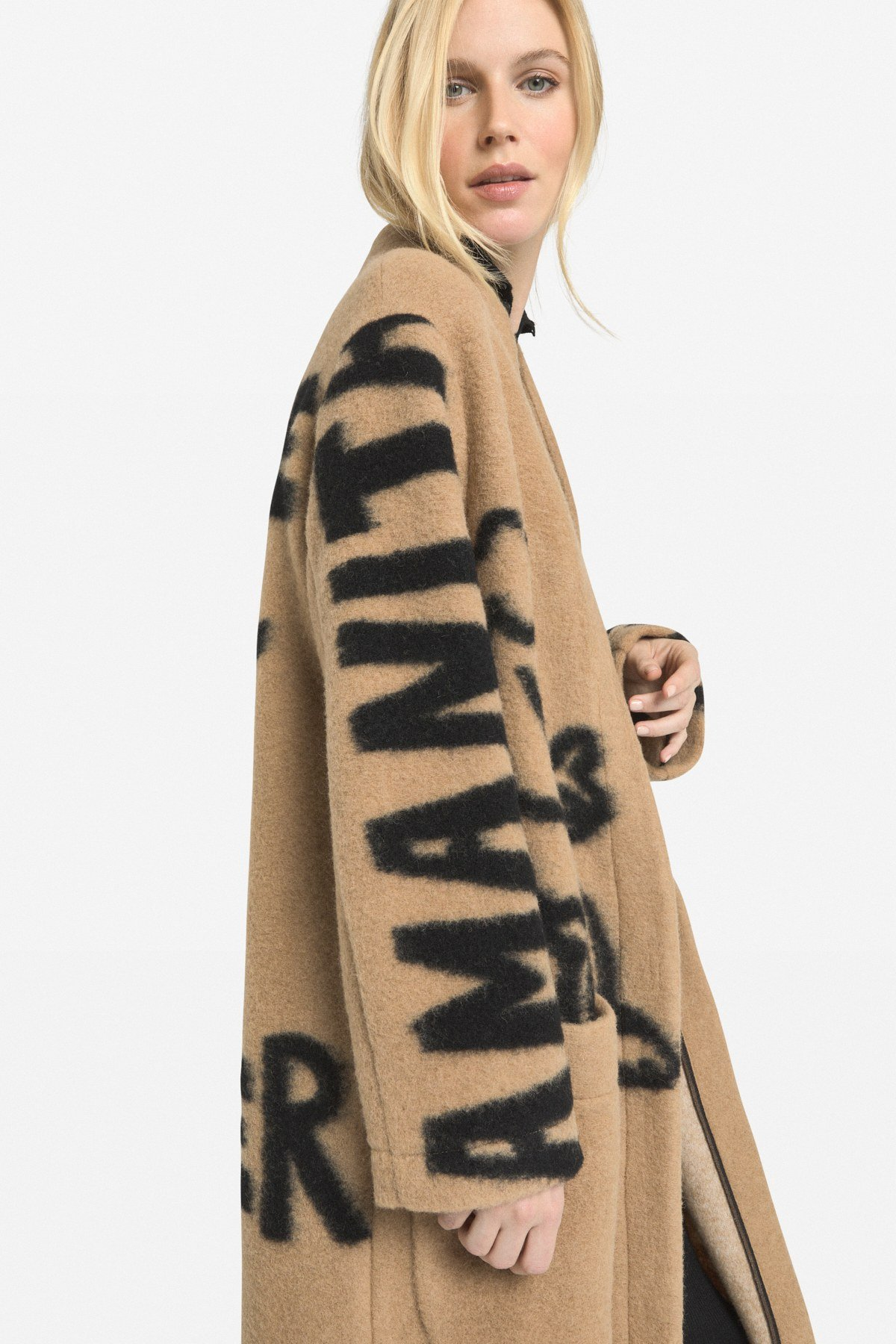 Oversized coat with embroideries