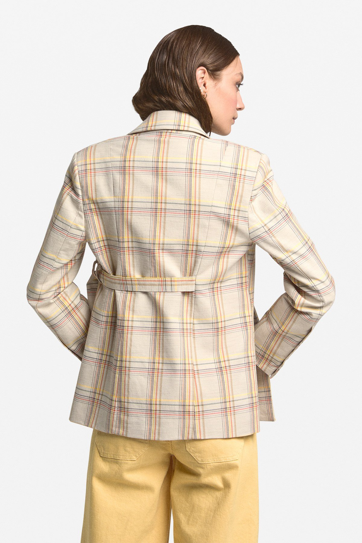 Patterned jacket with criss-cross buttoning