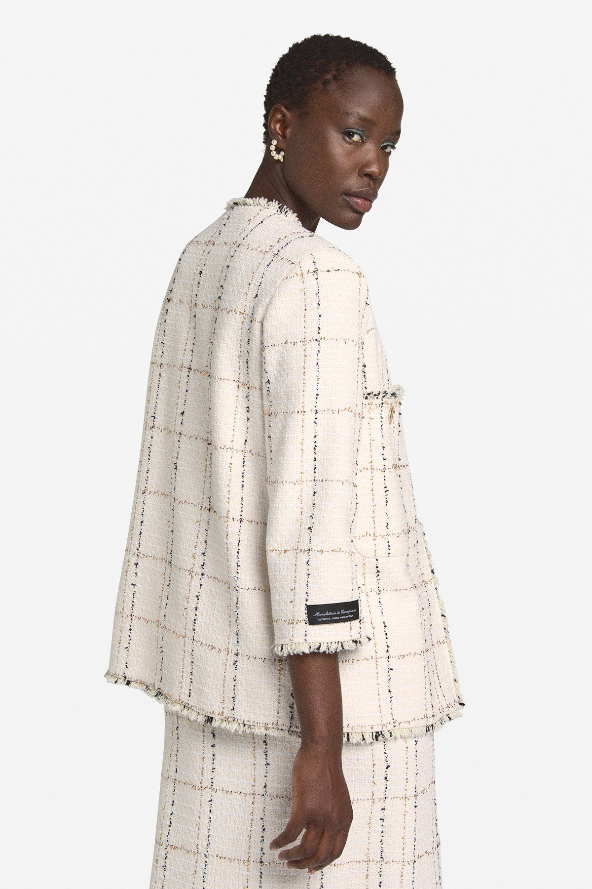 Jacket with raw cut hemline