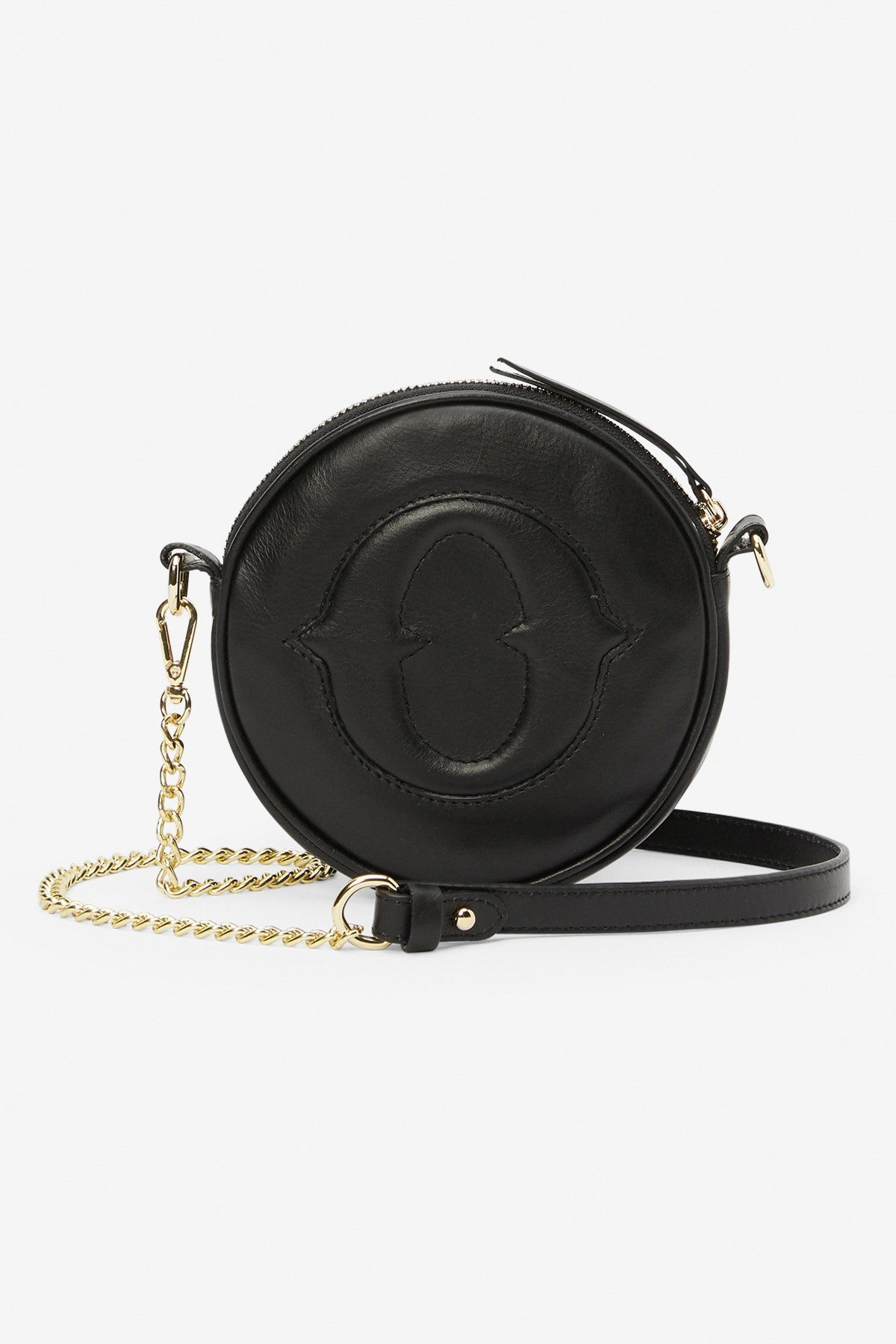 Small and round leather handbag with strap