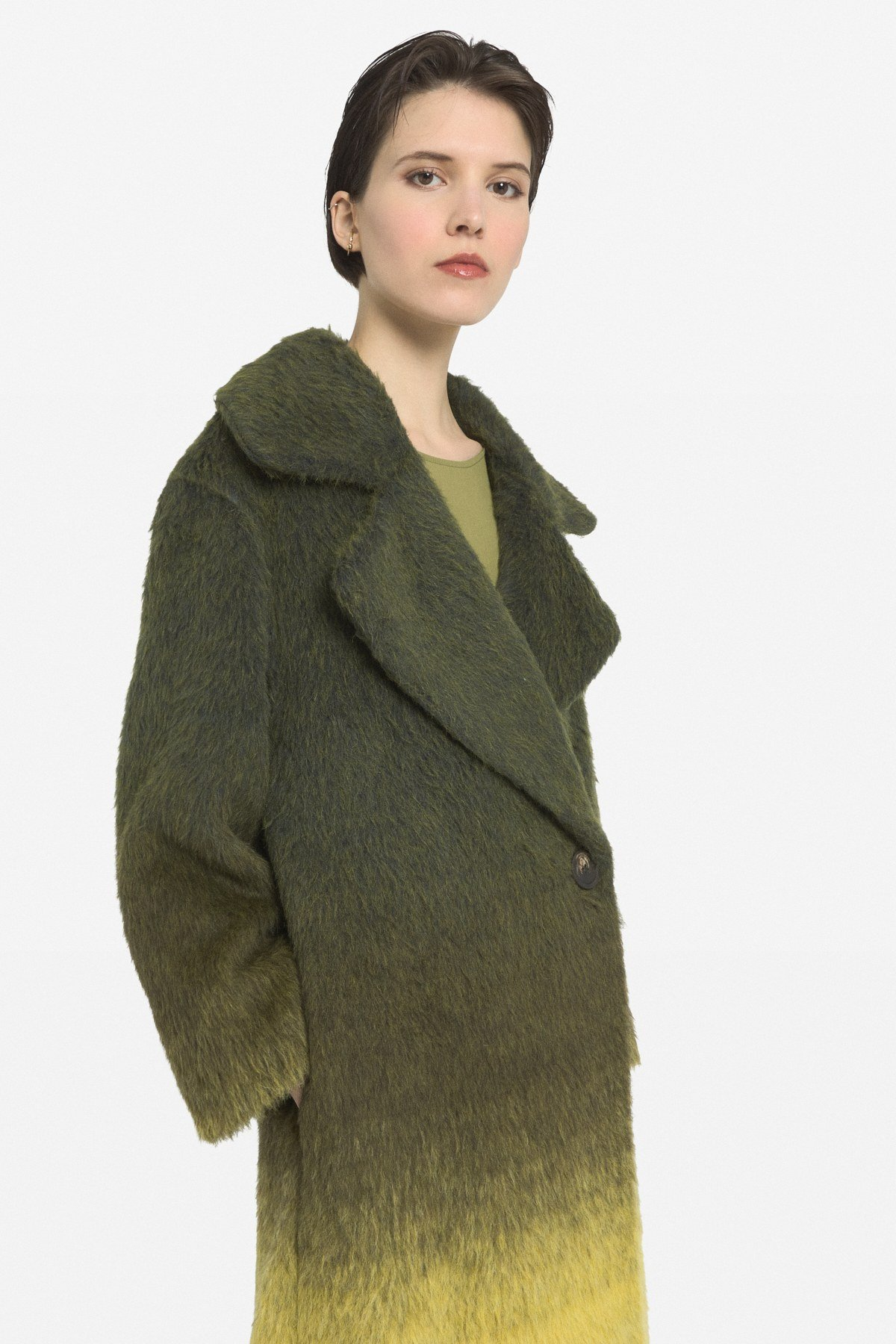 Coat with side fastening