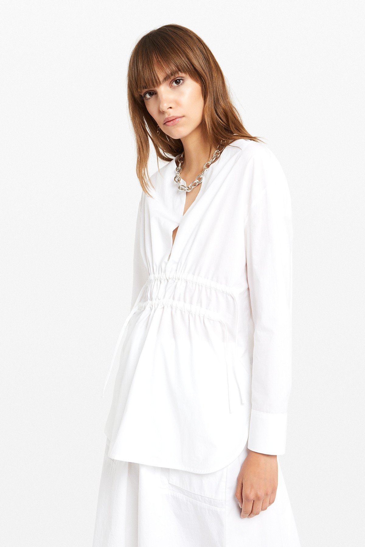 Poplin blouse with double drawstring at the waist