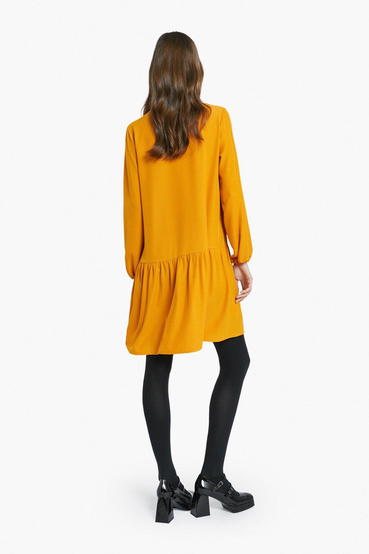 Mini dress with ruffle and zipper