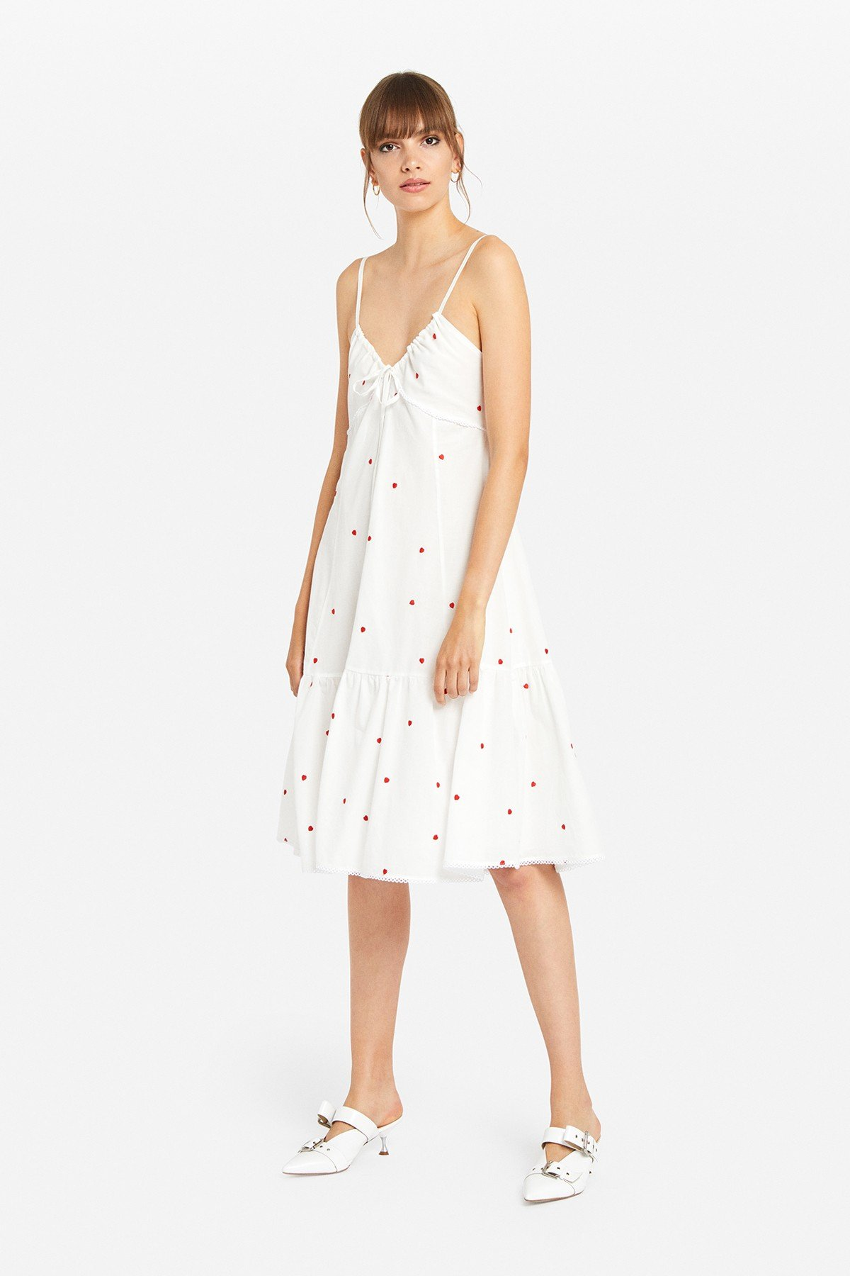 Embroidered dress with drawstring and maxi ruffle